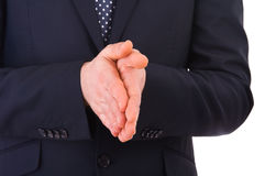 Businessman rubbing his hands together. Royalty Free Stock Images