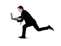 Business man run with laptop Stock Photo