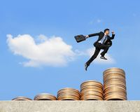 Business man run on money Royalty Free Stock Image