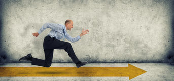 Business man run on yellow arrow. Business man running fast on yellow arrow Royalty Free Stock Image