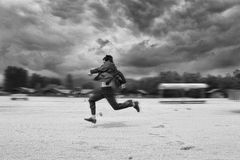 Business Man Runing In The Beach. Motion Blur Stock Photos