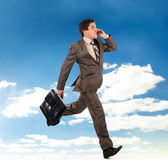Business man running with a briefcase Royalty Free Stock Photography
