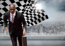Business man running with briefcase against skyline with sun and checkered flag. Digital composite of Business man running with briefcase against skyline with Royalty Free Stock Photo
