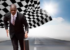 Business man running with briefcase on road against sky with sun and checkered flag. Digital composite of Business man running with briefcase on road against sky Royalty Free Stock Image