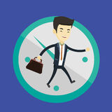Business man running on clock background. Royalty Free Stock Photo