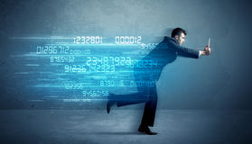 Business man running with device and data concept Stock Photos