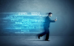 Business man running with device and data concept Stock Photo