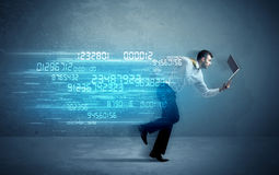 Business man running with device and data concept Stock Images