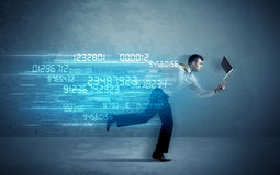 Business man running with device and data concept Royalty Free Stock Photos