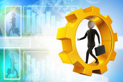 Business man running in gear wheels Stock Images