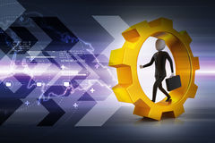 Business man running in gear wheels Stock Photography