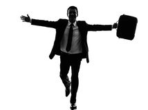 Business man running happy arms outstretched silhouette. One caucasian business man running happy arms outstretched in silhouette  on white background Royalty Free Stock Photo