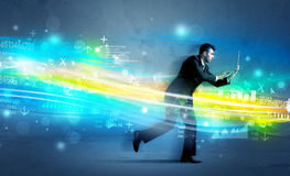 Business man running in high tech wave concept. Business man running with device in high tech wave cloud concept on background Stock Images