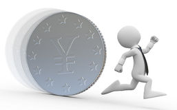A business man running from a huge coin with the y Stock Image