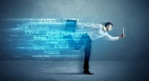 Business man running with device and data concept royalty free stock image