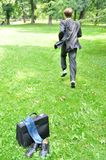 Business man running in park - escape Stock Photo
