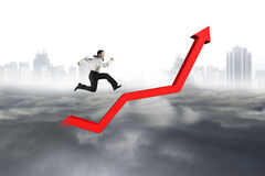 Business man running on red growth trend line Royalty Free Stock Photo