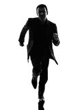 Business man running silhouette Royalty Free Stock Photo