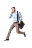 Business man running and speaking by phone Stock Photo