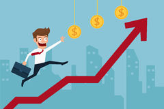 Business man running top of graph and striving to achieve his goal of higher profits. Stock Photo