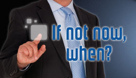 Finger on touch screen. Business man's finger pressing button on touch screen with text ' If not now when Stock Photos