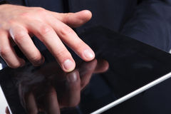 Business man's fingers on tablet Stock Images