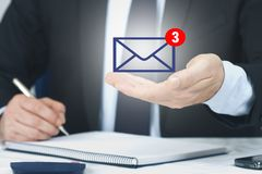 Email and messages. Business man`s hand with email and messages stock photo