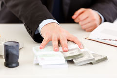 Business man's hand giving money packs Royalty Free Stock Photos