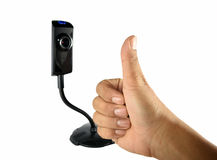 Business man`s hand with thumbs up gesture in front of the webcam. Business man`s hand with thumbs up gesture to the next person in the web Royalty Free Stock Image
