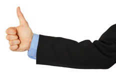 Business man's hand with a thumbs up sign  Stock Images