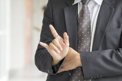 Business Man's hands and fingers making a gesture Royalty Free Stock Images