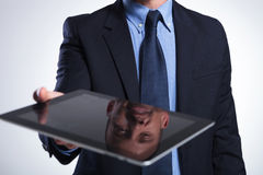 Business man's reflection on tablet Royalty Free Stock Image