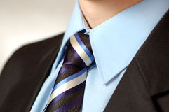 Business man's tie and hand Royalty Free Stock Image