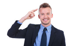 Business man salutes with two fingers Stock Image