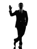Business man saluting  silhouette Stock Images