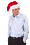 Business Man in Santa Hat with Cheeky Grin. Handsome Smiling Business Man in Santa Christmas Hat with Impish Grin Stock Photos