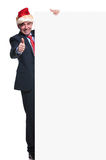 Business man with santa hat is making ok sign while holding a bo royalty free stock photography