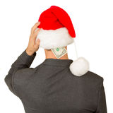 Business man with a santa hat, santa's crisis budget Stock Image