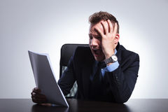 Business man scared by papers Royalty Free Stock Image