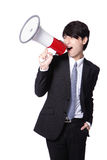 Business man screaming loudly in a megaphone. Isolated on white background, model is a asian male Stock Photos