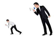 Business man screaming on megaphone Royalty Free Stock Photo