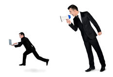 Business man screaming on megaphone Stock Photo