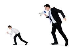 Business man screaming on megaphone Royalty Free Stock Image