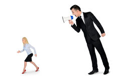 Business man screaming on megaphone Royalty Free Stock Images