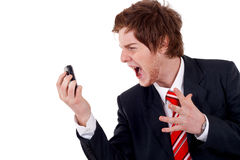 Business man screaming on the phone Stock Photography
