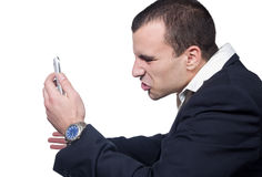 BUSINESS MAN SCREAMING ON THE PHONE Stock Photos