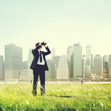 Business Man Searching Binoculars Outdoors Concept Stock Photography