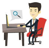 Business man searching information on internet. Young asian business man working on his laptop in office and searching information on internet. Concept of Stock Image
