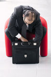 Business man searching for something in his briefcase Royalty Free Stock Photos