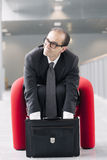 Business man searching for something in his briefcase Stock Photo